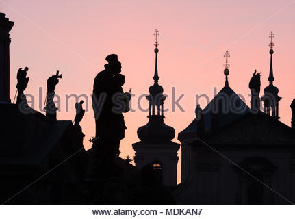 Silhouettes of towers and figures on Charles Bridge in Prague, Czech Republic - Stock Photo