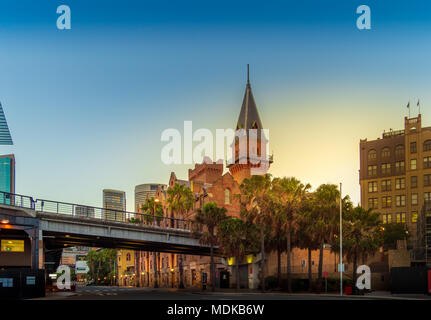 Sunset over The Rocks and the Australian Steam Navigation Building, Sydney..  Taken from Circular Quay. - Stock Photo