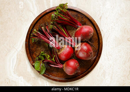 Fresh beetroots on metal tray on marble table - Stock Photo