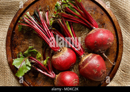 Close-up of fresh beetroots on metal tray on hessian sack cloth - Stock Photo
