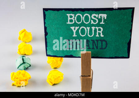 Handwriting text writing Boost Your Brand. Concept meaning improve your models name in your field overcome competitors written Sticky Note Paper holdi - Stock Photo