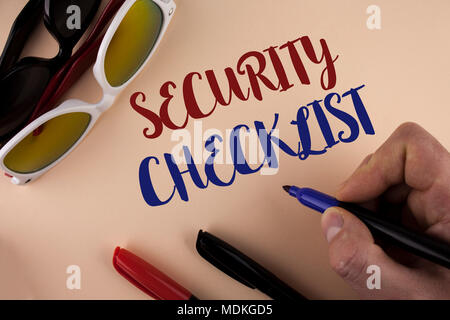 Text sign showing Security Checklist. Conceptual photo list with authorized names to enter allowing procedures written by Man plain background holding - Stock Photo