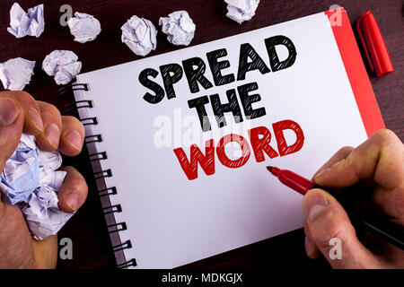 Conceptual hand writing showing Spread The Word. Business photo text Run advertisements to increase store sales many fold written by Man Notepad woode - Stock Photo