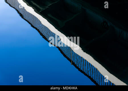 Reflection of bridge in water of Spree River - Stock Photo