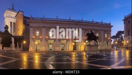Capitol Square with equestrian statue, Piazza del Campidoglio, Capitoline Museums in the back, dusk, Palazzo Nuovo, Rome, Lazio - Stock Photo