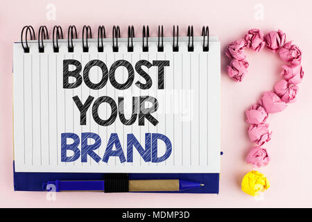 Handwriting text Boost Your Brand. Concept meaning improve your models name in your field overcome competitors written Notebook Book the plain backgro - Stock Photo