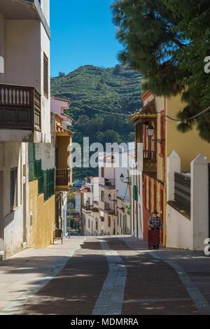 Teror, Spain - February 27, 2018: One of the attractive streets in Teror, popular tourist destination on Gran Canaria island. - Stock Photo