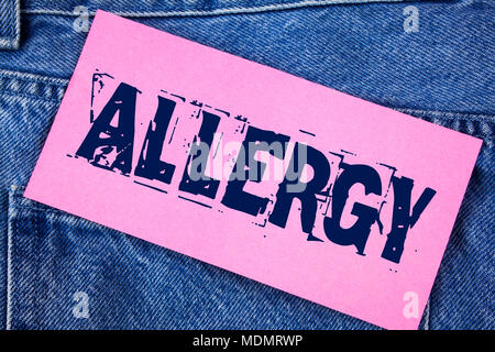 Handwriting text Allergy. Concept meaning damages in immunity due to hypersensitivity get it diagnised written Sticky Note Paper the Jeans background. - Stock Photo