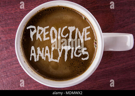 Writing note showing  Predictive Analytics. Business photo showcasing Method to forecast Performance Statistical Analysis written Coffee in White Cup  - Stock Photo