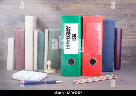 Risk Assessment. Binder on desk in the office. Business background  - Stock Photo