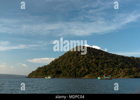 Mpay bay fisherman village, close to Koh rong Samloem island. Lonely small island visible in the distance and fisherman boats. - Stock Photo