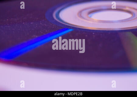 Macro closeup of Compact CD or DVD disc in violet color. - Stock Photo