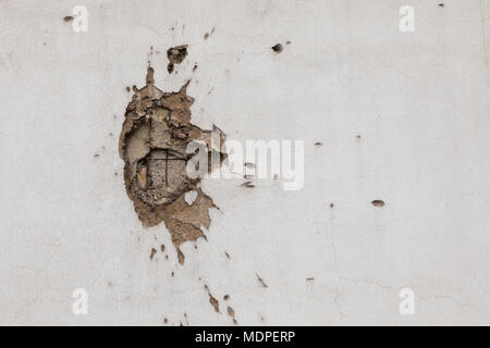 Bullet hole on building wall in Sarajevo - Stock Photo