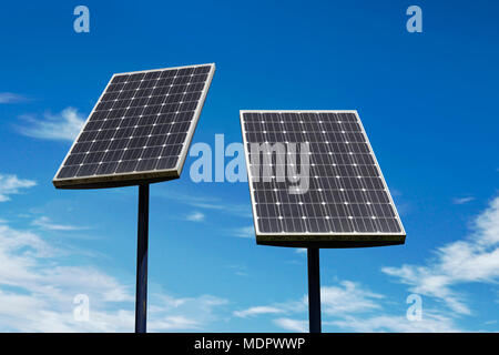 Small Solar Panels Against a Blue Sky - Stock Photo