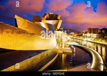 Bilbao, Spain; Guggenheim Museum at dusk - Stock Photo