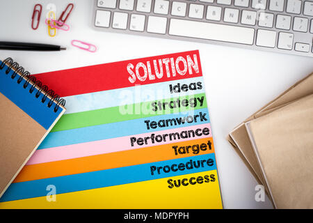 Solution concept. Office desk with a computer keyboard and color pages - Stock Photo