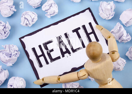 Handwriting text writing Health. Concept meaning State of being free from Illness Injuries Mental Physical condition written Sticky note paper within  - Stock Photo