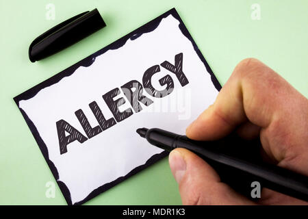 Handwriting text Allergy. Concept meaning damages in immunity due to hypersensitivity get it diagnised written by Man White sticky note paper holding  - Stock Photo