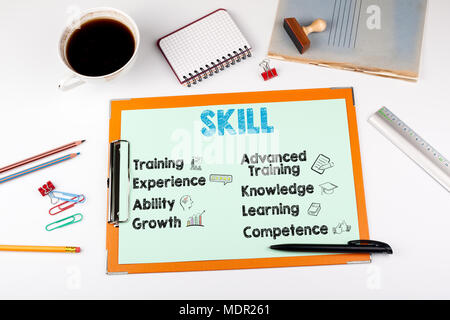 Skill Concept, keywords and icons. Office desk with stationery - Stock Photo