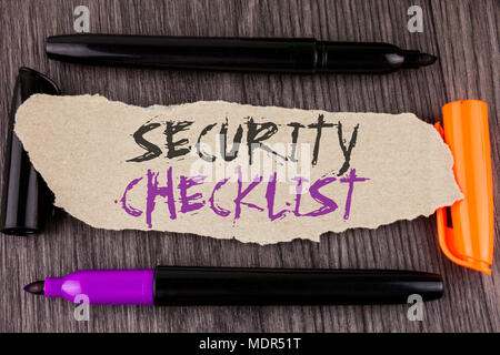 Text sign showing Security Checklist. Conceptual photo list with authorized names to enter allowing procedures written Tear Cardboard Paper the wooden - Stock Photo