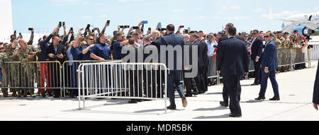 KEY WEST, Florida (April 19, 2018) President of the United States Donald J. Trump greets the crowd at Naval Air Station Key West's Boca Chica Field. During the president's trip to Key West, he spoke to service members and guests and received a brief from Joint Interagency Task Force South, U.S. Northern Command and U.S. Southern Command. NAS Key West is a state-of-the-art facility for air-to-air combat fighter aircraft of all military services and provides world-class pierside support to U.S. and foreign naval vessels. (U.S. Navy photo by Mass Communication Specialist 2nd Class Cody R. Babin/R - Stock Photo