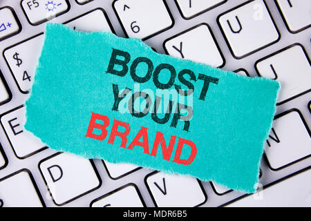 Handwriting text writing Boost Your Brand. Concept meaning improve your models name in your field overcome competitors written tear Sticky Note Paper  - Stock Photo