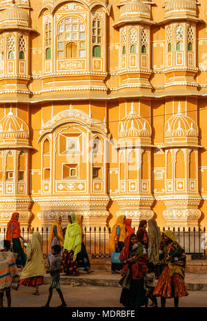 Jaipur, India; women in the street in front of the Hawa Mahal, Palace of the Winds. - Stock Photo