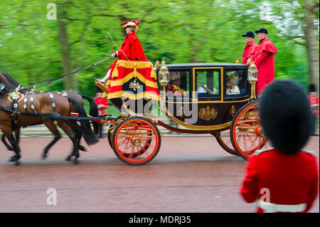 LONDON - MAY 18, 2016: A horse-drawn royal carriage passes in front of a guard from the household calvary on The Mall. - Stock Photo