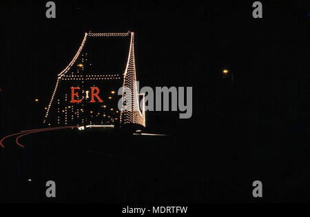 Brisbane's Story Bridge decorated with lights, 1954. Location: Brisbane, Queensland   Description:  Story Bridge lighting has ER in red lights and was decorated for the royal visit of Queen Elizabeth II. - Stock Photo