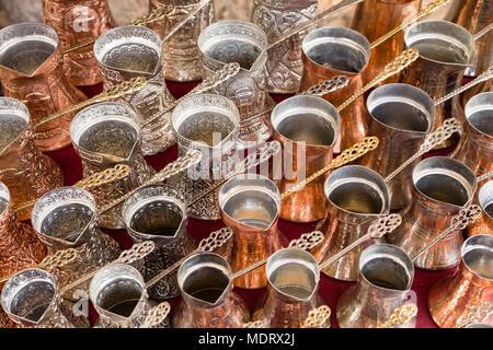Sarajevo, Bosnia-Herzegovina, July 16 2017: Traditional handcrafted copper coffee pots in souvenir shops in Sarajevo - Stock Photo