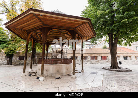 Sarajevo, Bosnia-Herzegovina, July 16 2017: The fountain in the courtyard of Gazi Husrev-beg Mosque in old town of Sarajevo - Stock Photo