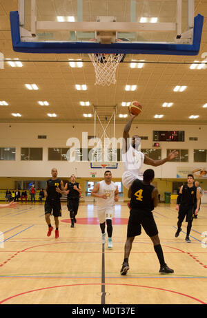 171202-F-GF466-1078 SHAPE, Belgium (Dec. 2, 2017) Supreme Headquarters Allied Powers Europe (SHAPE) Basketball Team member Travis Bell attempts a two-point shot around Belgium team member Claudy Bolampete during game 17 of the 2017 SHAPE International Basketball Tournament. The annual event brings together teams from around the world for friendly competition and partnership at a prominent NATO installation.(U.S. Air Force photo by Broadcast Journalist Airman 1st Class Hannah Anderson/Released) - Stock Photo