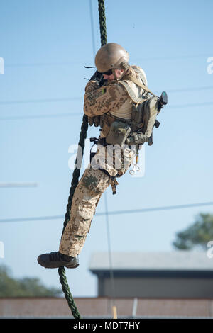 171204-N-SF508-233 VIRGINIA BEACH, Va. (Dec. 4, 2017) A German Navy explosive ordnance disposal technician fast ropes during helicopter rope suspension technique training as part of a subject matter expert exchange hosted by Explosive Ordnance Disposal Mobile Unit (EODMU) 12 at Joint Expeditionary Base Little Creek. EODMU 12 provides credible, combat-ready EOD forces capable of deploying anywhere, anytime in support of national interests. (U.S. Navy photo by Mass Communication Specialist 2nd Class Charles Oki/Released) - Stock Photo