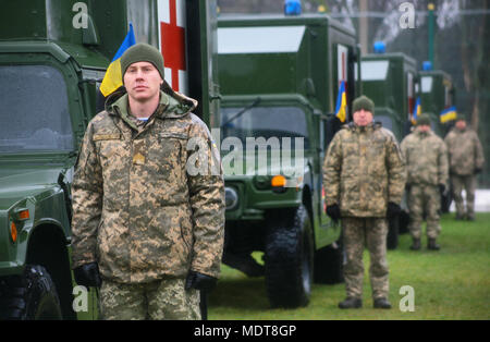 Yavoriv, Ukraine – Ukrainian soldiers assigned to the Yavoriv Combat Training Center attend a Ukrainian Armed Forces Day ceremony Dec. 6. As part of the ceremony the United States presented the Ukrainian Ministry of Defense with 40 military ambulances. (U.S. Army photo by Sgt. Alexander Rector) - Stock Photo