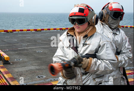 171206-N-VK310-0030 ATLANTIC OCEAN  (Dec. 6, 2017) Sailors participate in an aviation firefighting drill on the flight deck of  the amphibious assault ship USS Wasp (LHD 1). Wasp is transiting to Sasebo, Japan to conduct a turnover with the USS Bonhomme Richard (LHD 6) as the forward-deployed flagship of the amphibious forces in the U.S. 7th Fleet area of operations. (U.S. Navy photo by Mass Communication Specialist 3rd Class Michael Molina/Released) - Stock Photo