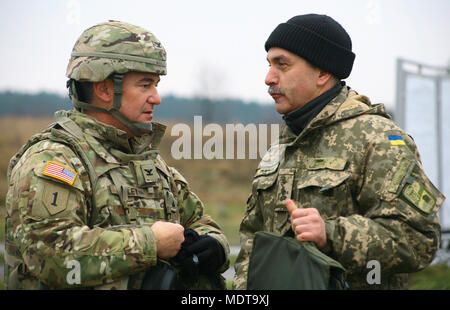 Yavoriv, Ukraine – Col. Dennis Deeley, the 27th Infantry Brigade Combat Team (forward) commander converses with Ukrainian Col. Valentin Levchik during a Ukrainian Army live-fire exercise at the Yavoriv Combat Training Center (CTC) Dec. 7. More than 220 New York Army National Guard soldiers are assigned to the CTC where they are mentoring Ukrainian soldiers toward their goal of obtaining NATO interoperability. (U.S. Army photo by Sgt. Alexander Rector) - Stock Photo