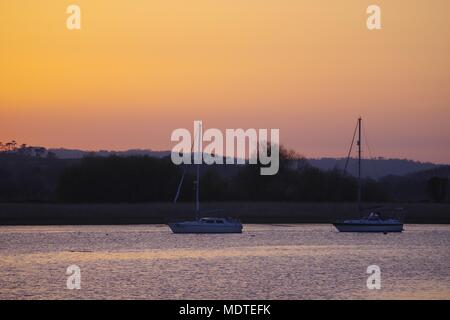 Pleasure Yachts Moored on the Exe Estuary at Sunset. Topsham, Exeter, Devon, UK. April, 2018. - Stock Photo