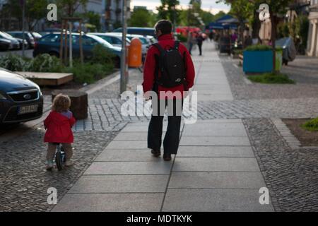 Germany, Berlin, Prenzlauer Berg, Oderberger Strasse, child riding on the pavement, - Stock Photo