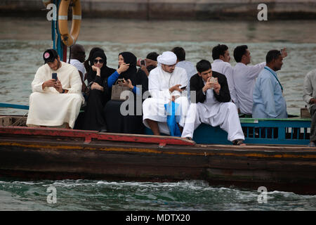 Local people crossing the Dubai Creek on an abra, Dubai, United Arab Emirates, Middle East - Stock Photo