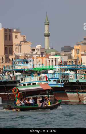 Local people crossing the Dubai Creek on an abra, Deira, Dubai, United Arab Emirates, Middle East - Stock Photo