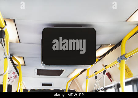 Blank Billboard in Public Subway. black TV without information inside the bus. Video advertising in public transport. Mock up electronic media board w - Stock Photo