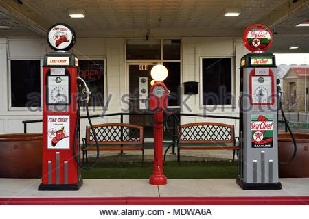 Antique art deco style gasoline station pumps, old fashioned vintage filling station pumps in the USA. - Stock Photo