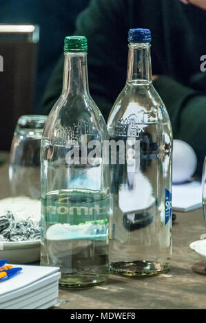 Mineral water bottles on a table. - Stock Photo