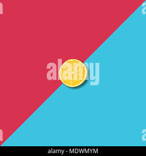 Minimalist abstract illustration with single lemon slice on vibrant red and turquoise background - Stock Photo