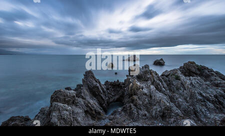 A long exposure of Torre de la Sal & rocks under a dramatic sky taken on the south coast of Spain. - Stock Photo