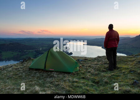Backpacker Enjoying the View Over Ullswater from Hallin Fell at Dawn, Lake District, Cumbria, UK. - Stock Photo