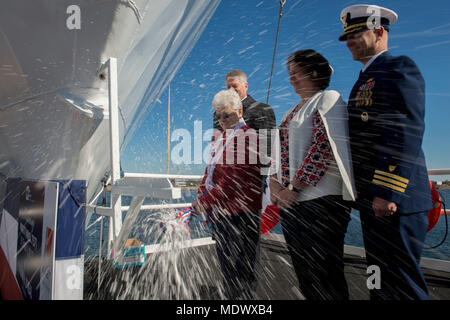 The Coast Guard Cutter Midgett's (WMSL 757) sponsor, Jazania H. O'neal, breaks a bottle of champagne across the bow during the ship's christening ceremony in Pascagoula, Miss., Saturday, Dec. 9, 2017. Midgett  is named in honor of 10 members of the Midgett family who earned seven gold and three silver Lifesaving Medals for their heroic deeds and decades of service. Coast Guard photo by Petty Officer 3rd Class Brandon Giles. - Stock Photo