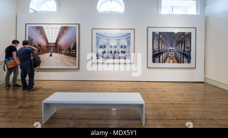 London, UK.  20 April 2018. Visitors view images by Candida Höfer (Outstanding Contribution to Photography) at the 2018 Sony World Photography Awards Exhibition at Somerset House.  The 11th edition of the competition saw 320,000 submissions from over 200 countries.  The exhibition runs 20 April to 6 May.  Credit: Stephen Chung / Alamy Live News - Stock Photo