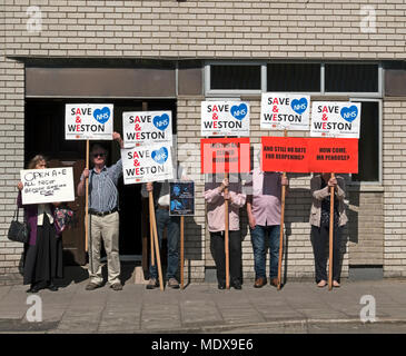 Weston-super-Mare, UK. 20th April 2018. Demonstrators gather outside the local Conservative Party office to protest against the continued overnight closure of the accident and emergency department at Weston General Hospital. Despite assurances that the closure is only a temporary measure, it has been in effect since July 2017, and the planned merger between Weston Area Health NHS Trust and University Hospitals Bristol NHS Foundation Trust has created further uncertainty about Weston General Hospital's future. Keith Ramsey/Alamy Live News - Stock Photo