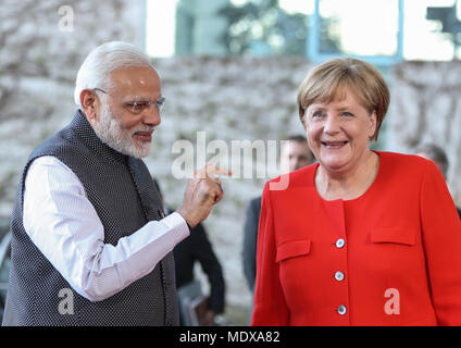 Berlin, Germany. 20th Apr, 2018. German Chancellor Angela Merkel (R) talks with visiting Indian Prime Minister Narendra Modi at German Chancellery in Berlin, capital of Germany, on April 20, 2018. German Chancellor Angela Merkel on Friday evening received Indian Prime Minister Narendra Modi in his stopover in Berlin, but no details of meeting was revealed. Credit: Shan Yuqi/Xinhua/Alamy Live News - Stock Photo
